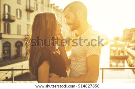 Shutterstock Couple romantic moment on a bridge