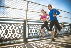 Couple running in Brooklyn. Urban runners on the move in New york