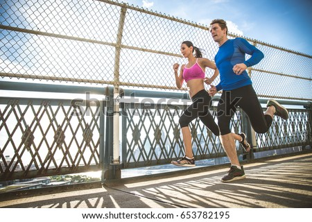 Couple running in Brooklyn. Urban runners on the move in New york #653782195