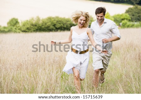 Couple running outdoors smiling