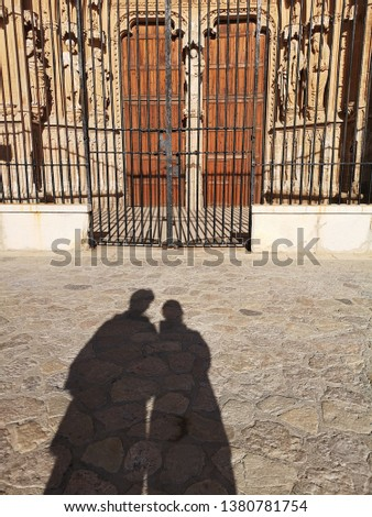 Couple shadow in front of the closing gate at the Cathedral of Santa Maria of Palma. Secret Lovers, Lover Journeys in Europe. Romantic and relationship concept. #1380781754