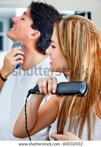 Couple shaving, brushing hair and getting ready in the morning