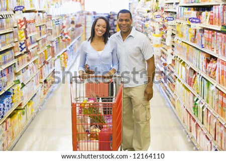 Couple shopping for groceries in supermarket