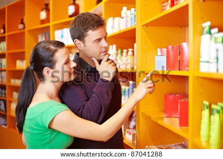 Couple shopping for medical products in a pharmacy