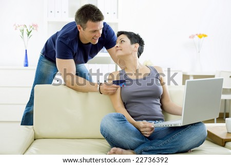 Couple shopping on internet paying by credit card.
