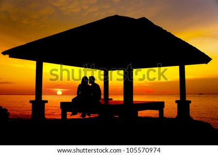 couple silhouette with great sunset