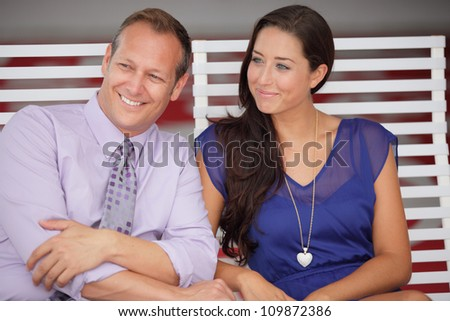 Couple sitting and smiling - stock photo