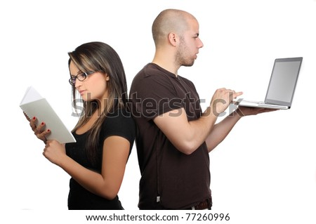 Couple sitting back to back, woman reading book while husband working on laptop