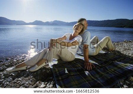 Photo of Couple sitting by lake in Germany