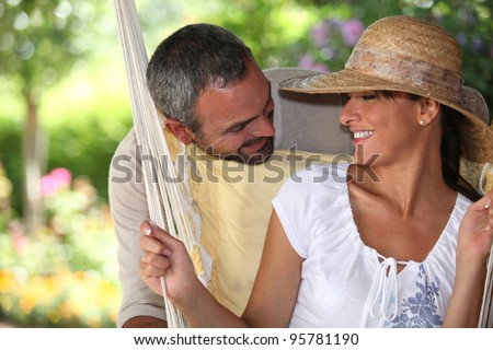 Couple sitting in a hammock
