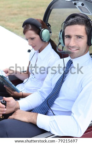 Couple sitting in the cockpit of a light aircraft