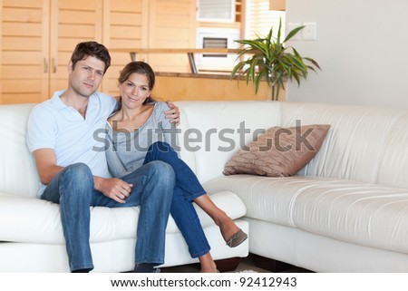 Couple sitting on a couch in their living room