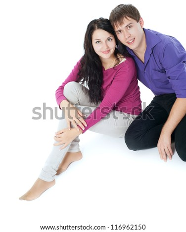 Couple sitting on the floor, white background