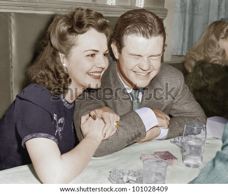 Couple sitting together laughing and happy