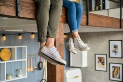 couple sitting with legs dangling