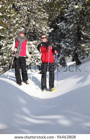 Couple skiing together