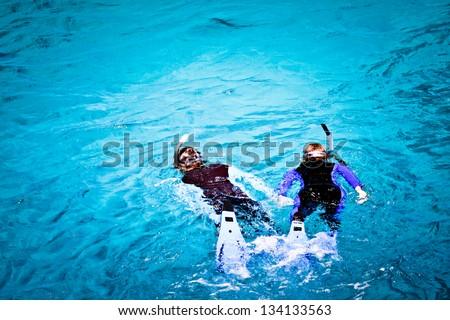 Stock Photo Couple skorkelling on the Great Barrier Reef, Australia