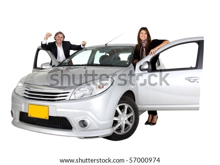 Couple smiling with a car isolated over a white background
