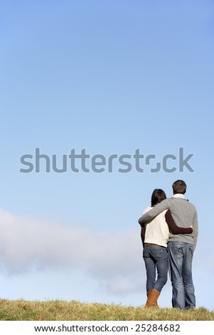 Couple Standing In The Park