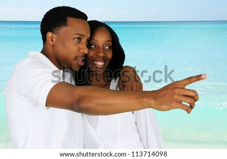 Couple standing together while they are at the beach