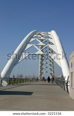 couple strolls along pedestrian bridge #3221536