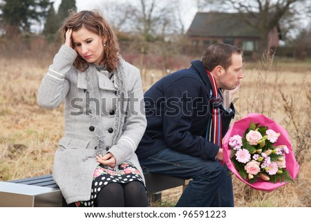 Couple struggling with their relationship while sitting on bench