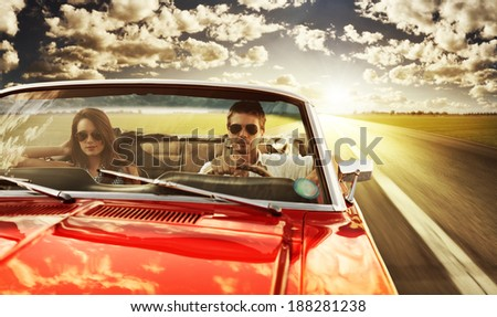 couple taking a road trip in...