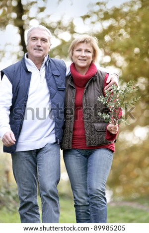Couple taking a walk through woodland