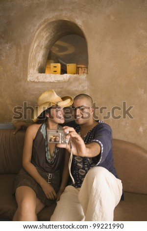 Couple taking self-portrait with camera