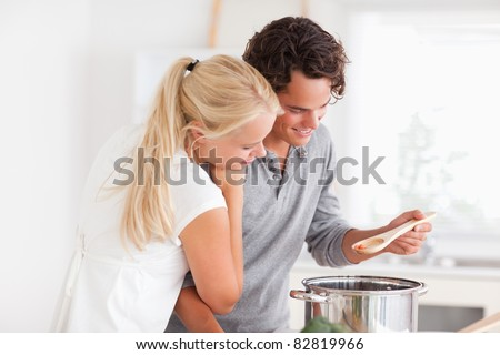 Couple tasting a meal in a boiler - stock photo