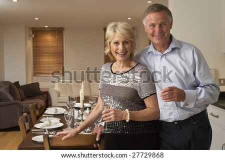 Couple Throwing A Dinner Party