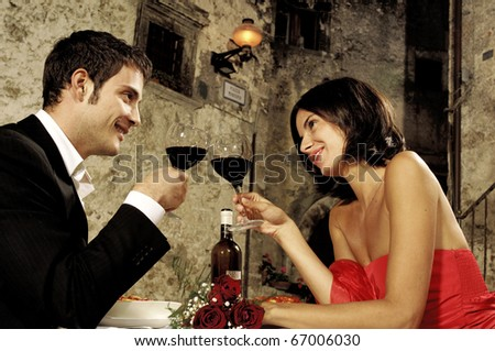 couple toasting at restaurant