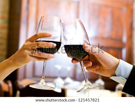 Couple toasting wine glasses