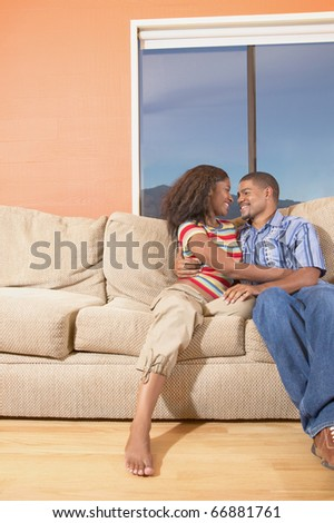 Couple together on couch
