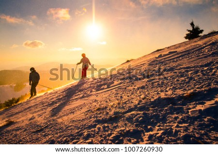 Couple together on ski. Winter sport photo with edit space.
