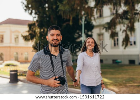 couple tourist in sightseeing in city using paper map