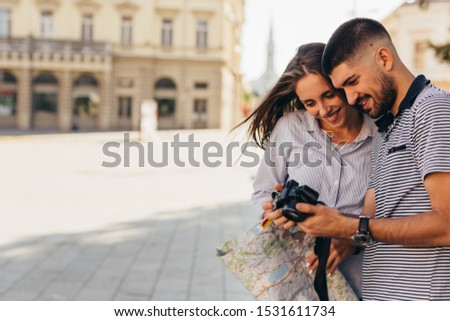 couple tourist in sightseeing in city using photo camera