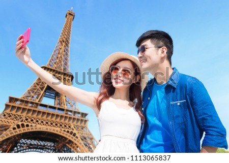 couple travel to paris and selfie happily #1113065837