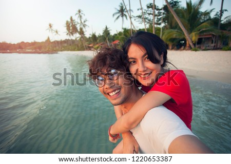 Couple traveler asian selfie on the beach.