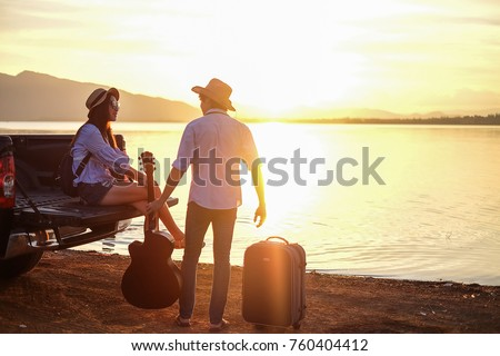 couple traveler playing guitar...