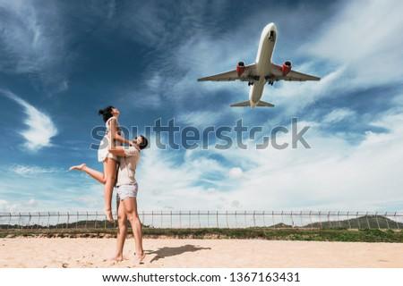 Couple travels the world. Beautiful couple on having fun on the beach. Happy couple on vacation. Honeymoon trip. Honeymoon lovers. Man and woman traveling. Wedding travel. Mai Khao Beach