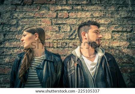 Couple turning heads in opposite directions - Two persons ignoring themselves after argument - Unhappy lovers
