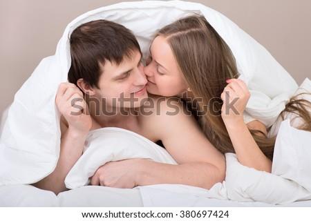 Couple Under Blanket 380697424