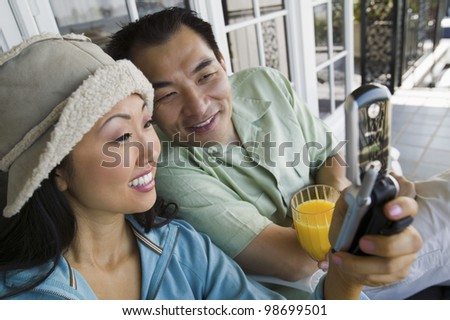 Couple Using Cell Phone