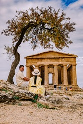 couple visit the famous Greek temples in Sicily, , Valley of the Temples, Agrigento, Sicily, Italy.