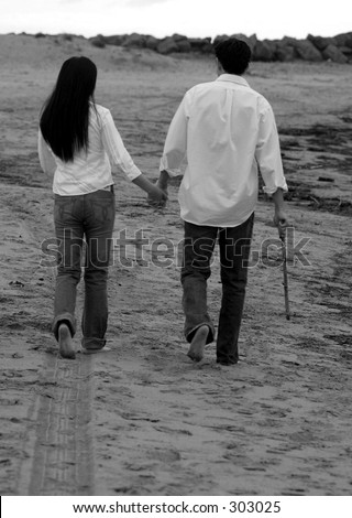 Couple Walking Away In The Sandy Beach Stock Photo 303025 ...