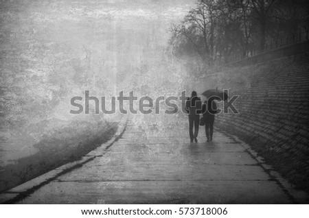 couple walking beside river on...