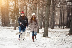 couple walking dog winter