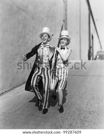 Couple walking down a street in a patriotic outfit