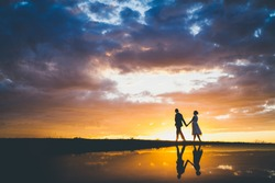 Couple walking in the sunset